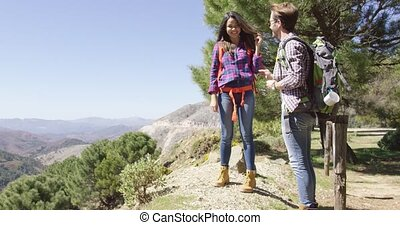 Young romantic couple in mountains - Young male giving...