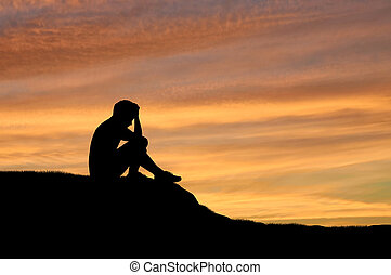 Child abuse and violence. Silhouette of a crying lonely boy...
