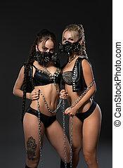 Sexy girls in bdsm masks and leather underwear