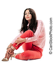Sexy woman in red jeans. Isolated