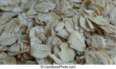 Oatmeal. Oat flakes. Close-up rotating. - Oatmeal. Oat...