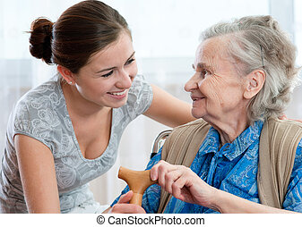nursing home - Senior woman with her home caregiver