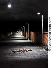 Sleeping outdoors - Asian girl lies in an empty street