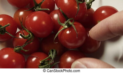 Taking Cherry Tomatoes From Bowl Closeup - A close up shot...