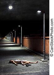 Dark and dangerous - Asian girl lies in an empty street
