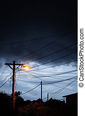 Street light at night with a stormy sky background