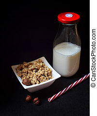 Musli - Healthy breakfast - cereal musli and milk on dark...