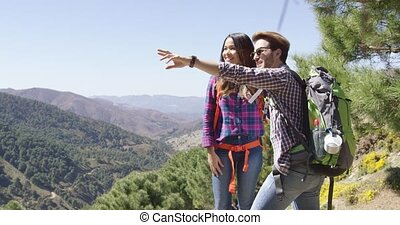 Young coupole having fun in mountains - Young couple hiking...