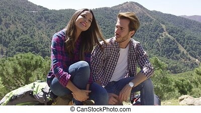 Young couple in mountains - Two people having rest while...