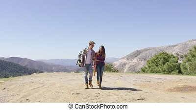 Loving couple walking in mountains - Romantic couple walking...
