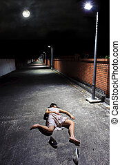 Full Moon - Asian girl lies in an empty street