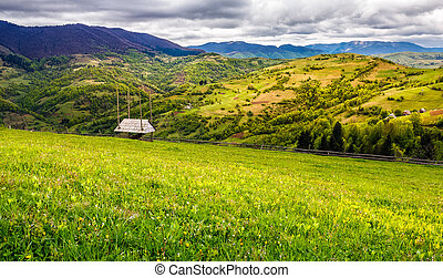 agricultural field in mountains - agricultural hay field in...