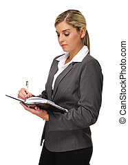 Attractive busineswoman - Young blonde business woman writes...