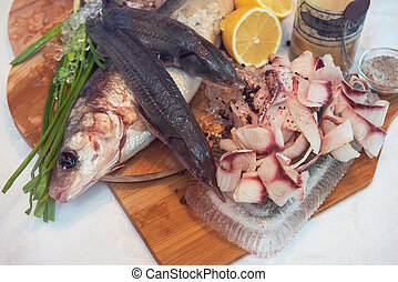 Sliced frozen raw fish from whitefish species - white...