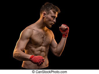 Blond man with muscular torso on black background