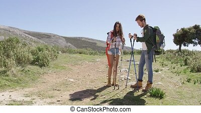 Young couple trekking in mountains - Young couple with...
