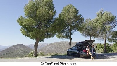 Car with tourists on mountain road - Tourists sitting in car...