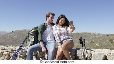 Sweet couple making selfie - Young couple taking selfie...