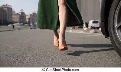 Sexy woman's legs in high heels walking in street - Sexy...