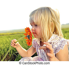 Smelling flowers - Adorable little girl smells the wild...