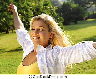 Stress free - Young blonde girl is happy and free outdoors