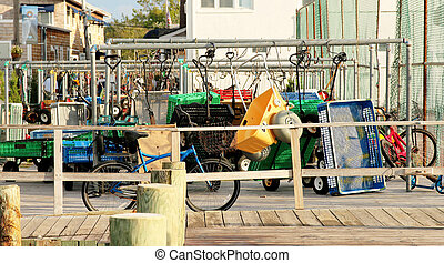 Wagons and bikes wait at the Ferry in Fire Island, NY -...