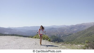 Young female tourist walking - Young fit female with...