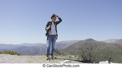 Young male tourist enjoying views - Young man holding...