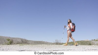Young female tourist walking - Woman with backpack and...