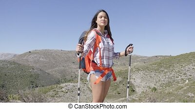 Attractive female traveller with backpack - Young pretty...