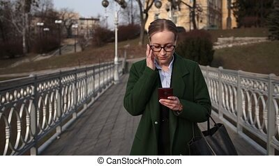 Fashionable busineswoman busy with mobile phone -...