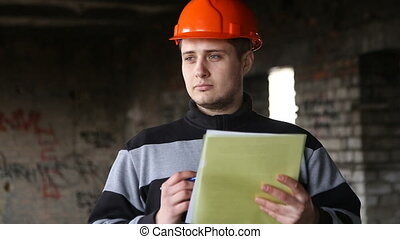 The engineer studies the working documents in the...