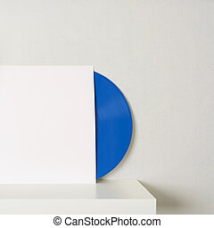 blue vinyl record in white paper case put on table and...