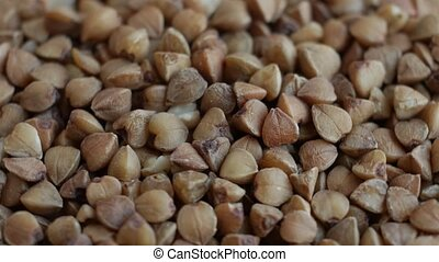 Rotating raw buckwheat.