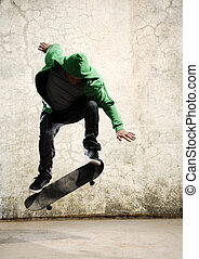 Grunge ollie - Skateboarder doing trick in mid air, grunge...
