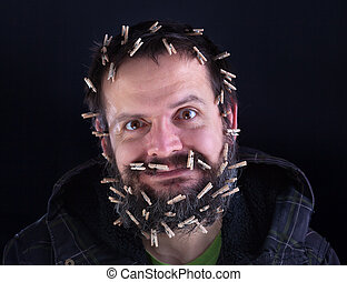 Barely holding it together - stressed man held together with lots of clothespins