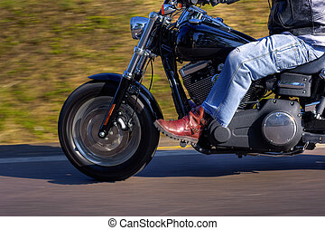 Motorbike speed - Motorbike moving at high speed on the road