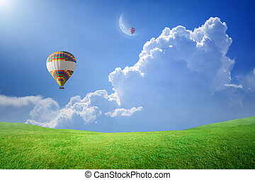 Hot air balloons rise up into blue sky to new moon - Idyllic...