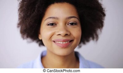 happy smiling african american young woman face - people,...