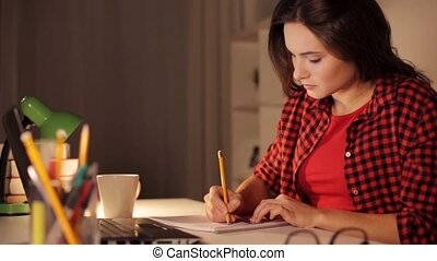 student girl with notebook and calculator at home - people,...