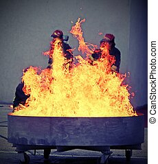 brave firefighters during the test of a fire extinguishing -...