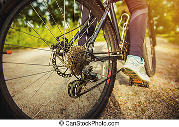 Athlete woman is running with her extreme mountain bike...