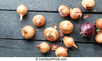 onions on rustic wood - Large onion harvest. Yellow onions...