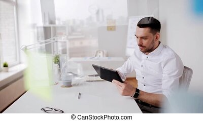businessman with tablet pc and coffee at office - business,...