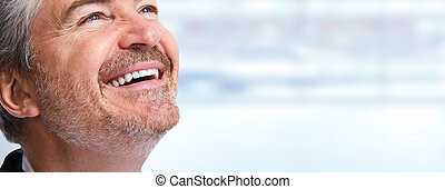 Man smile - Happy smiling man close-up over blue background