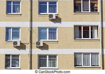 A fragment of a multi-storey brick residential building with installed air conditioning. Nizhny Novgorod. Russia.