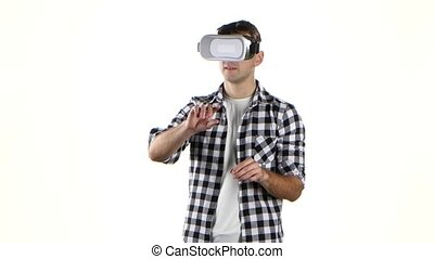 Man works with files in virtual reality glasses. Hand...