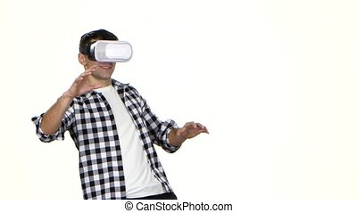 Man playing online game wearing virtual reality glasses....