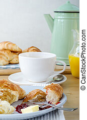 Continental Breakfast Setting on Light Wood Table -...