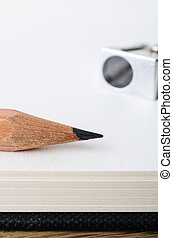 Pencil, Blank Sketchbook and Sharpener - Close up of the tip...